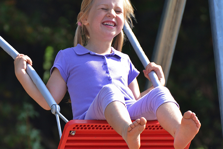 Girl swinging on safety swing seat