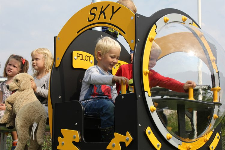Children playing in helicopter playhouse