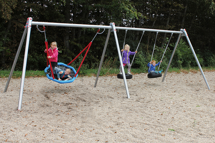 Swing frame with sensory swing and tyre swings